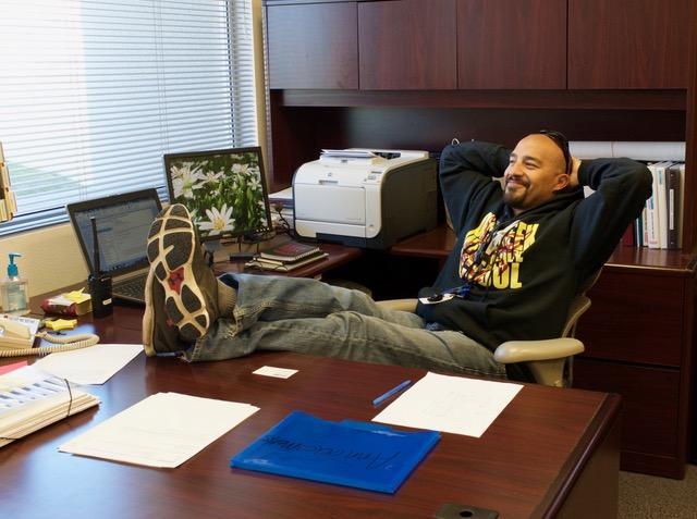 Vice+Principal+Mr.+Apodaca+relaxes+at+his+desk.