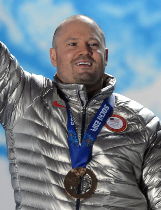 Former+U.S.+Army+World+Class+Athlete+Program+bobsledder+Steven+Holcomb+of+Park+City%2C+Utah%2C+and+Steve+Langton+of+Melrose%2C+Mass.%2C+hoist+the+flowers+and+display+their+broze+medals+during+the+Olympic+two-man+bobsled+medal+ceremony+Feb.+18++at+Olympic+Park+in+Sochi%2C+Russia.+U.S.+Army+photo+by+Tim+Hipps%2C+IMCOM+Public+Affairs