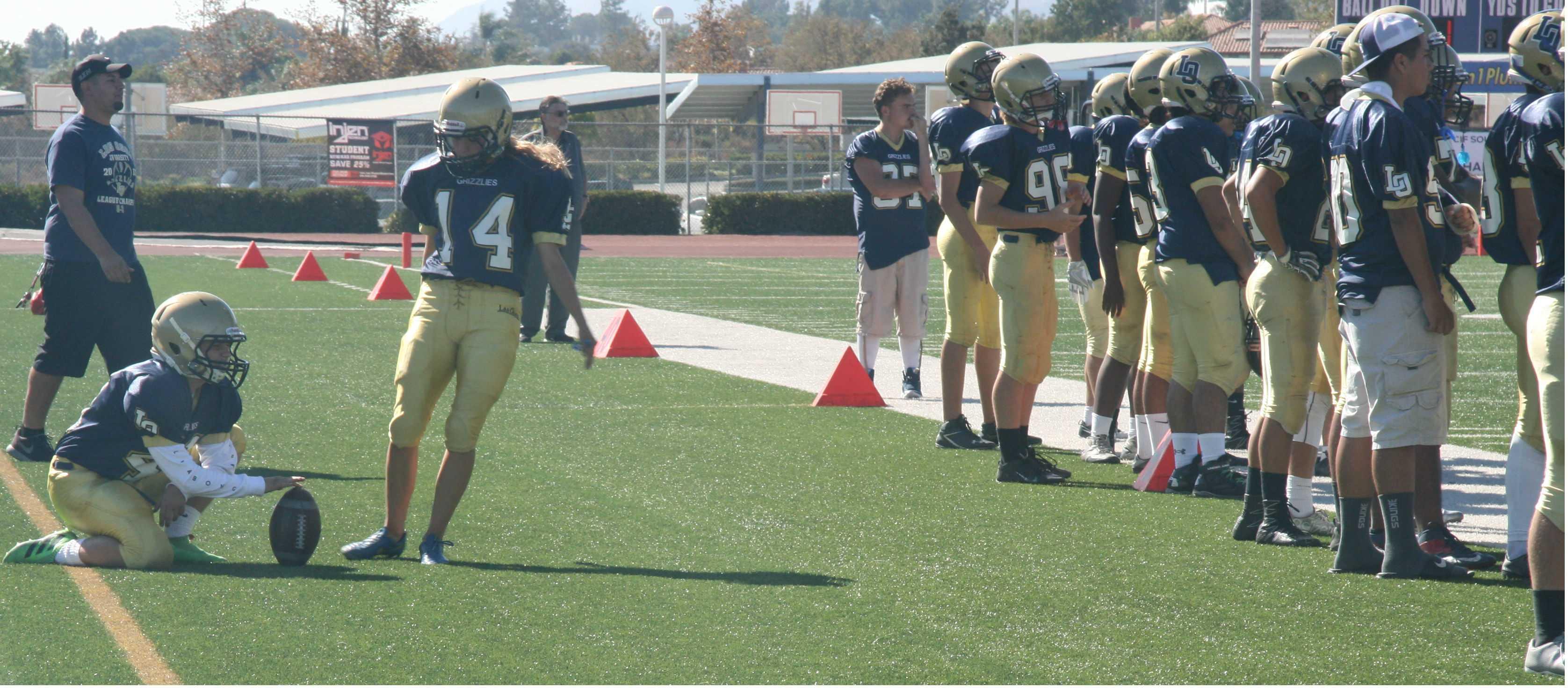 Hanna Moftman kicks a football during practice.