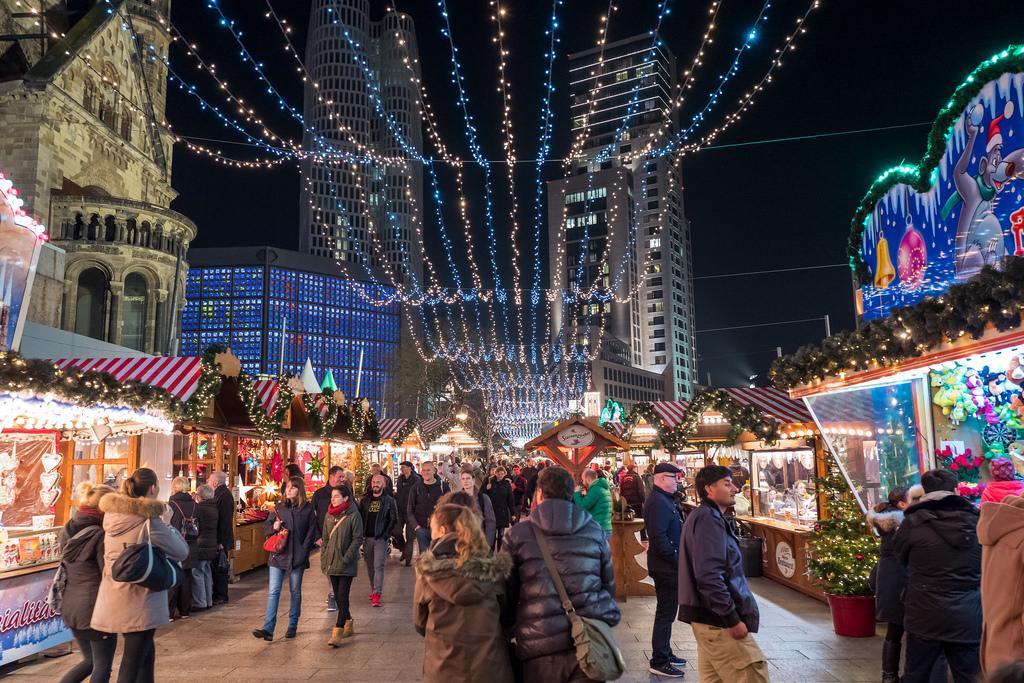 Shoppers swarm a busy market in Berlin.