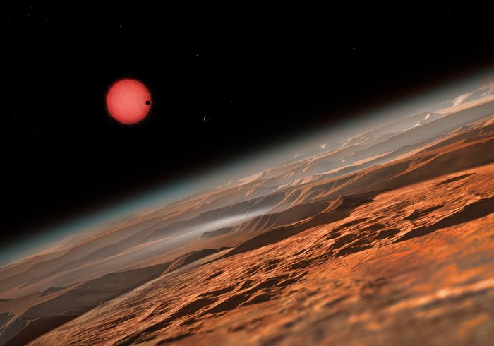 An+artist%27s+impression+of+Trappist-1+from+one+of+its+orbiting+planets.