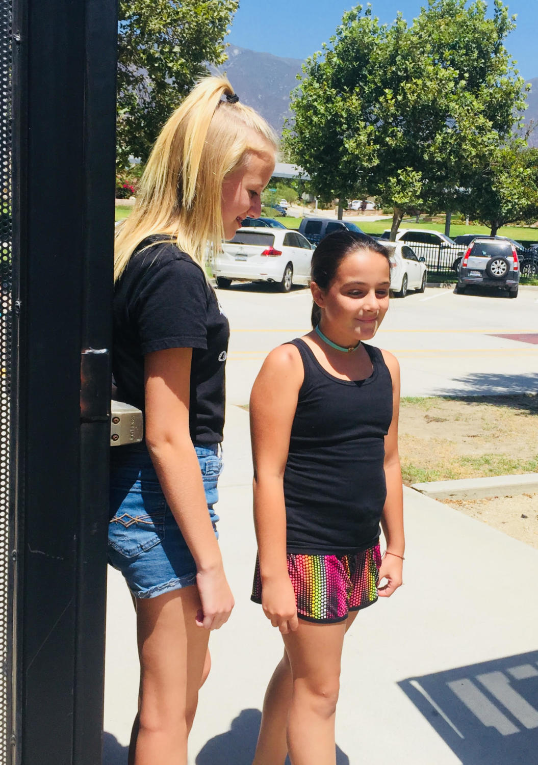 An eighth grader welcomes in a new sixth grader.