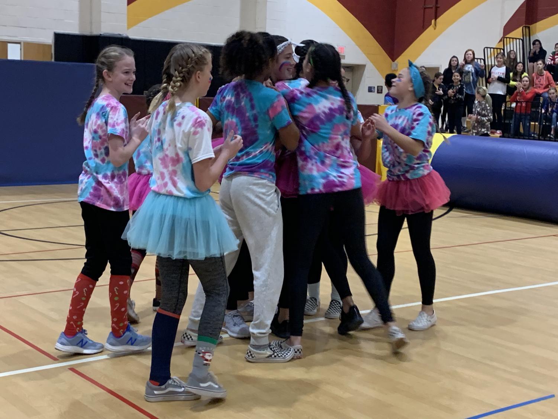 The+Weirdos+celebrate+after+winning+the+7th+Grade+Girls+Survivor+Ball+Tournament.