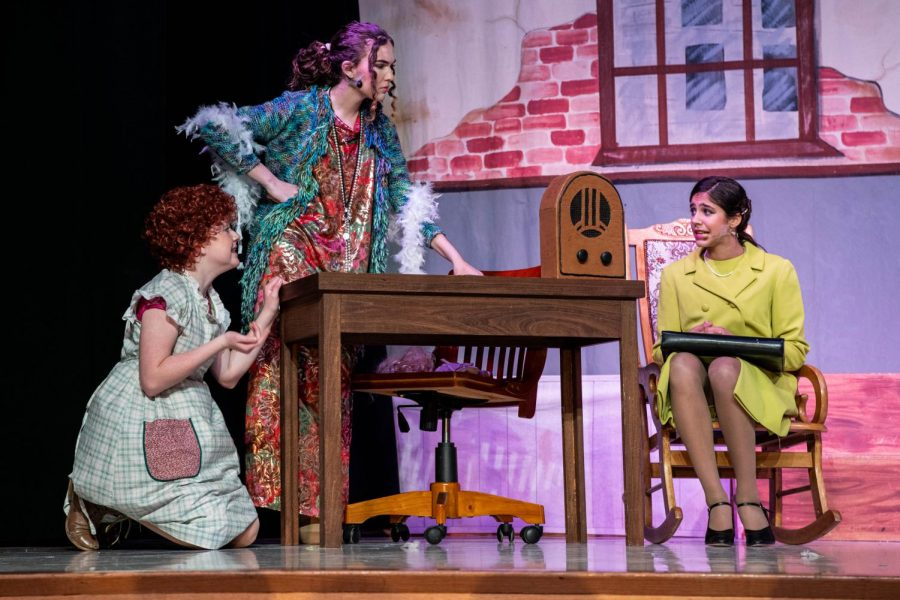 Annie begs Miss Hannigan to let her stay with Mr. Warbucks for Christmas