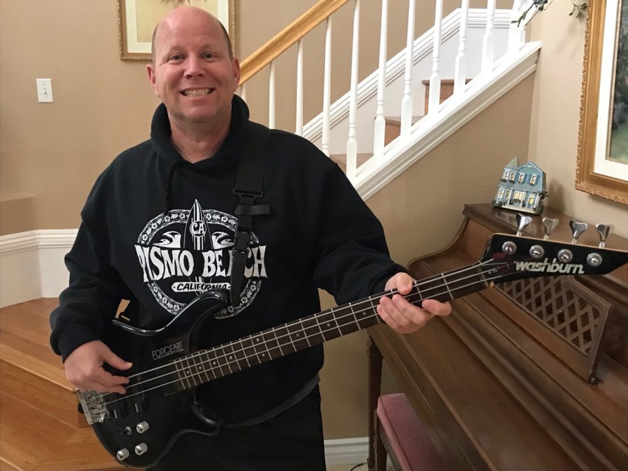 Mr. Henry likes to play his broken bass guitar that can only hold three strings.
