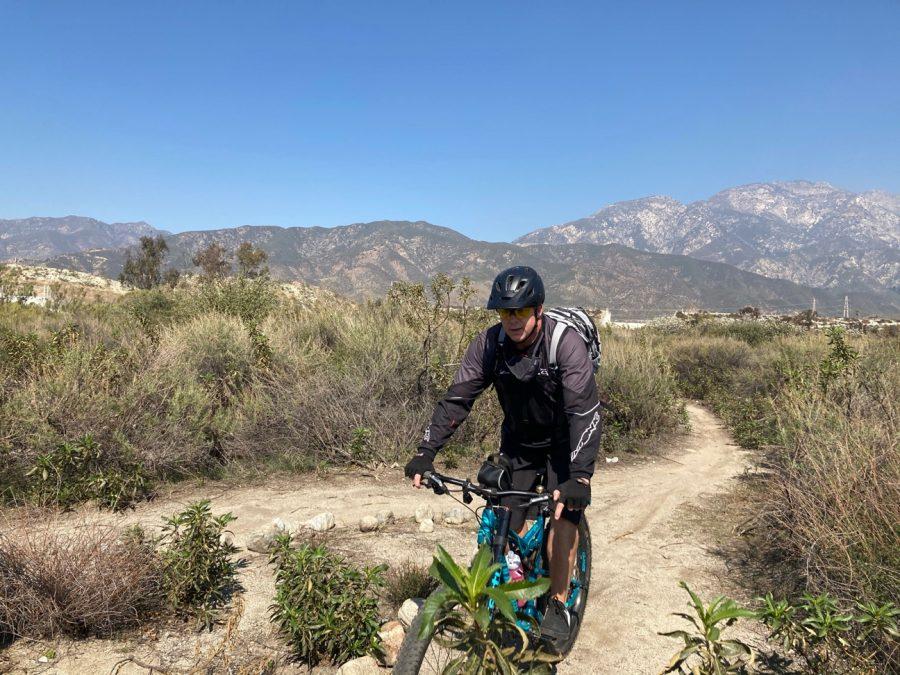 PE teacher, Mr. Nemecek, likes mountain biking with his wife.