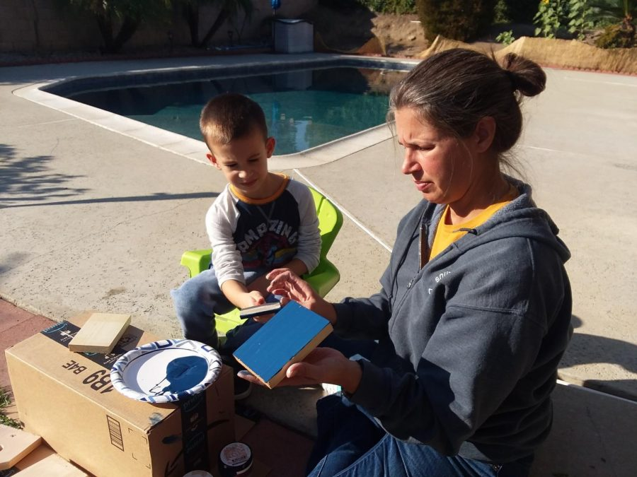 Mrs. Arellano really enjoys building objects and having fun with her son.